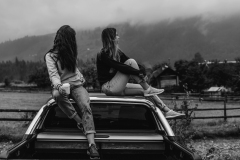 two-women-sitting-on-vehicle-roofs-2409681_sw