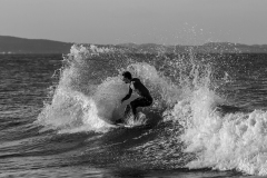 grayscale-photo-of-man-surfing-1554653_sw